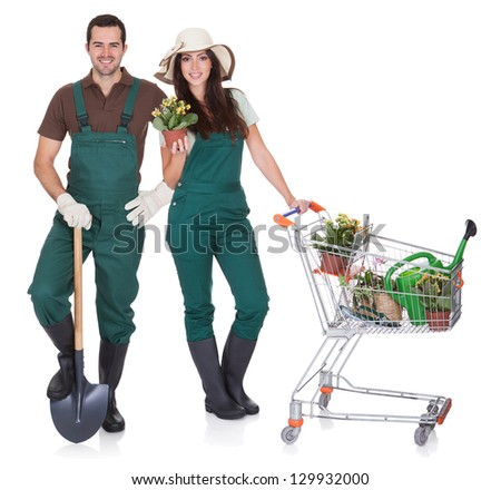 Portrait of male and female gardeners. Isolated on white - stock photo