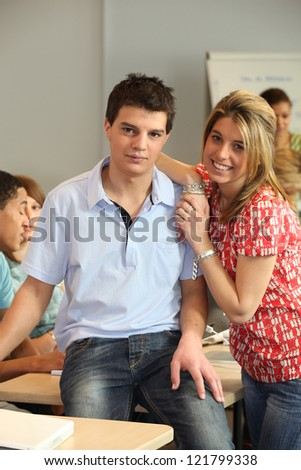 portrait of male and female student - stock photo