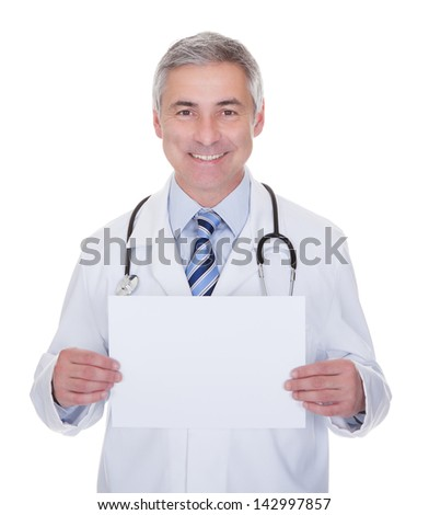 Portrait Of Male Doctor Holding Placard Over White Background