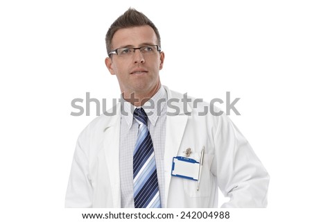 Portrait of male doctor in lab coat and glasses, looking away. - stock photo