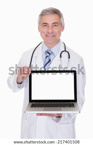 Portrait Of Male Doctor Showing Laptop Over White Background - stock photo