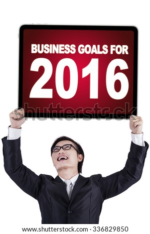 Portrait of male entrepreneur lifting up a board with a text of business goals for 2016 - stock photo