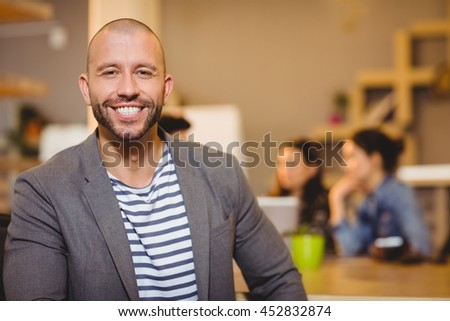 Portrait of male graphic designer smiling in the office