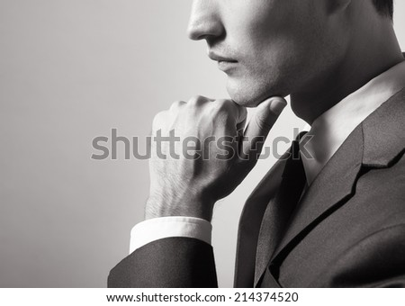 Portrait of male in a suit. - stock photo