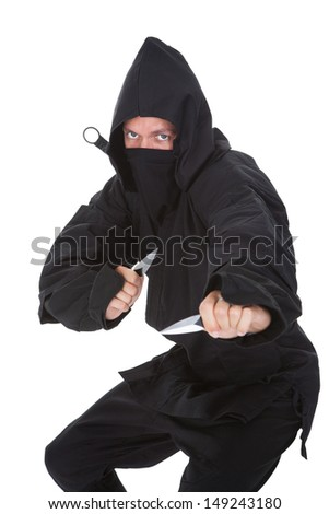 Portrait Of Male Ninja In Black Costume Isolated Over White Background