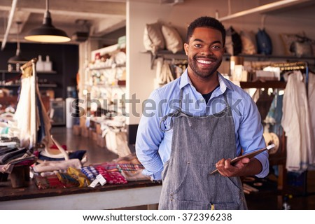 Portrait Of Male Owner Of Gift Store With Digital Tablet - stock photo