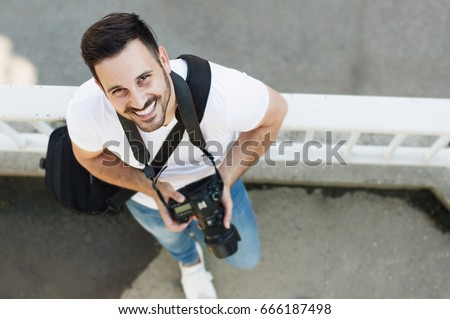 Portrait of male photographer with camera