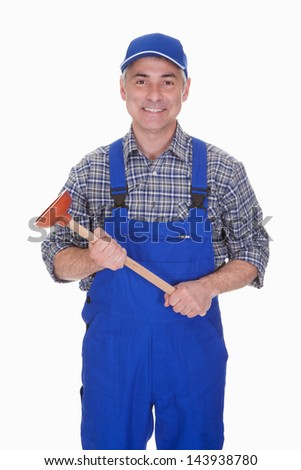 Portrait Of Male Plumber Holding Plunger Over White Background - stock photo
