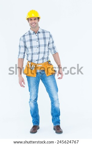 Portrait of male technician standing over white background