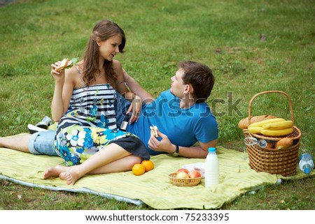 Portrait of man and his girlfriend on picnic