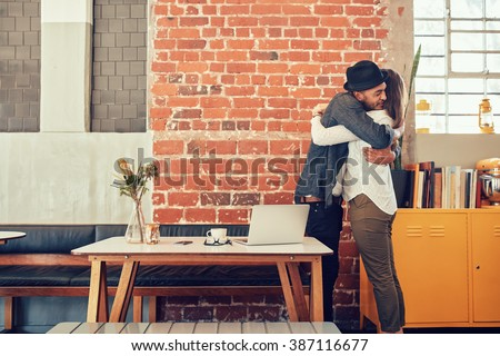 stock photo portrait of man and woman hugging and greeting each other at a coffee shop couple meeting in a 387116677 - Glucose Dating Tips For Sugar Going out with - May Try These kinds of Bad Glucose Dating Tips