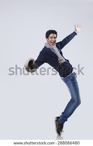 Portrait of man dancing over colored background