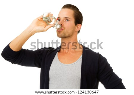 Portrait of man drinking fresh water from bottle. Isolated on white.