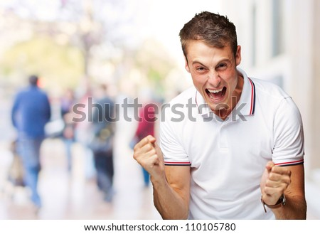 Portrait Of  Man Expressing His Excitement, Outdoor - stock photo