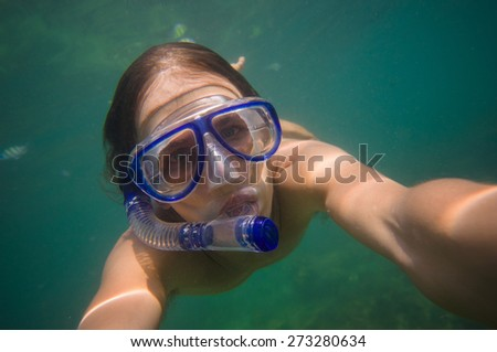 Portrait of man free dive snorkeling near coral tropical island - stock photo