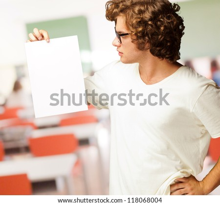 Portrait Of Man Holding A Blank Paper, Indoor
