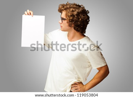 Portrait Of Man Holding A Blank Paper Isolated On Grey Background - stock photo