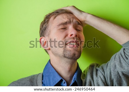 Portrait of Man Holding His Head in Stress