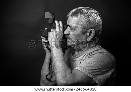 portrait of man holding vintage camera.