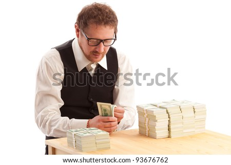 portrait of man in glasses counting bundles of money isolated on white - stock photo