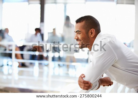 Portrait of man in office, side view - stock photo