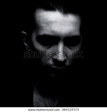 Portrait of man in shadow black and white