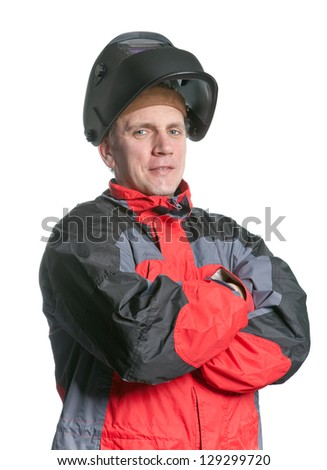 Portrait of man in working clothes and a welder mask - stock photo