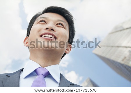 Portrait of Man Looking Up - stock photo