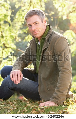 Portrait Of Man Outdoors In Autumn Landscape - stock photo