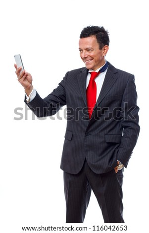 Portrait of man posing in studio in suit with phone