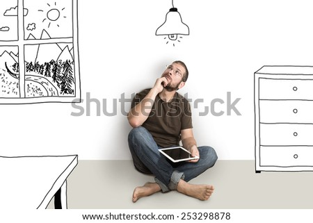 Portrait Of Man Sitting On Floor Looking Up While Dreaming Their New Home And Furnishing