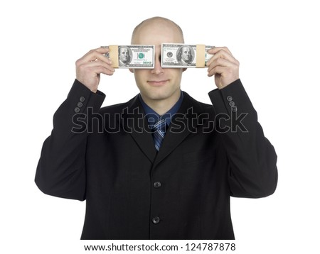 Portrait of man smiling while covering his eyes with banknote - stock photo