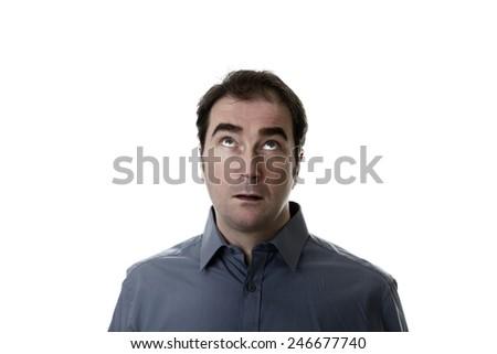 portrait of man taken in the studio looking up - stock photo