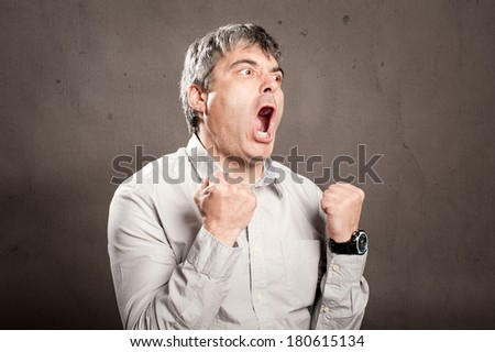 portrait of man with angry expression - stock photo