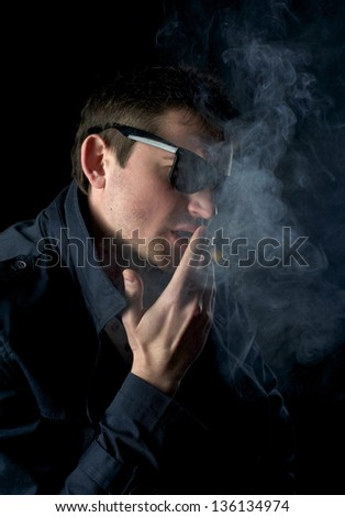 Portrait of man with cigar