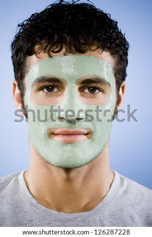 Portrait of man with cosmetic facial mask - stock photo