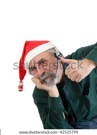 Portrait of man with santa´s hat working in a call center