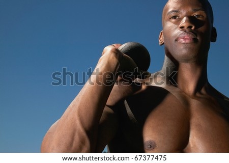 Portrait of man with shot put
