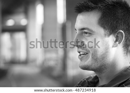 Portrait of man with smile on his face in black and white