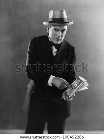 Portrait of man with stock certificates
