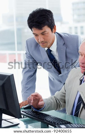 Portrait of managers during a meeting in an office - stock photo