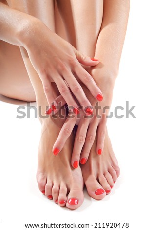 portrait of manicured nails and pedicured toes - stock photo