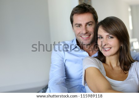 Portrait of married couple at home - stock photo