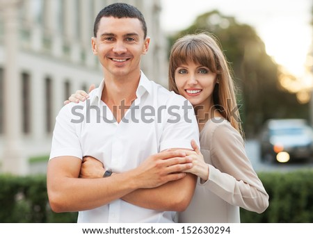 Portrait of married couple on street - stock photo