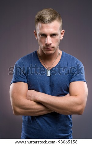 Portrait of masculine tough looking young man with serious expression and pose. - stock photo