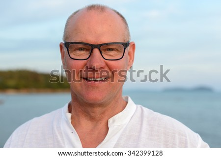 Portrait of mature adult man outdoors