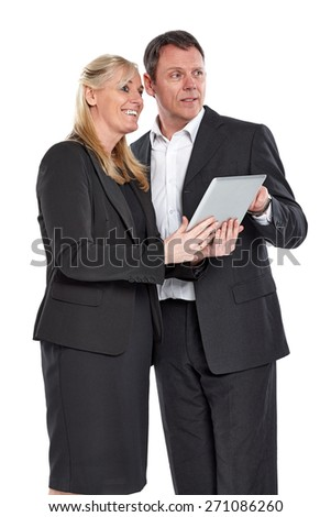 Portrait of mature business colleagues with digital tablet looking away against white background - stock photo
