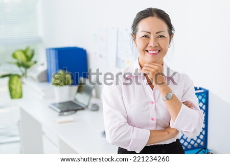 Portrait of mature business lady in the office - stock photo