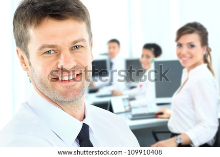Portrait of mature business man smiling with hands folded during meeting - stock photo
