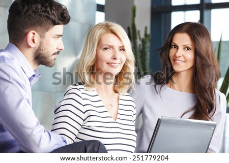 Portrait of mature business woman discussing her colleagues at meeting.  Business people.